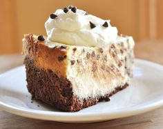 This chocolate chip cookie dough cheesecake is studded with morsels of cookie dough and mini chocolate chips, all atop a chocolatey crust. Chocolate Chip Cookie Cheesecake, Cookie Dough Cheesecake, Easy Chocolate Chip Cookies, Mini Chocolate Chips, Just Desserts, Delicious Desserts, Dessert Recipes, Yummy Food, Dessert Ideas