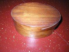 Archive photo: Spice Box, oval, wood.  Object ID: 1926.206. 001  As seen on the table in the Old Kitchen of the Historic Atwood House, Chatham, MA. #atwoodhouse, #spice, #box, #chathamhistoricalsociety, #chatham, #capecod