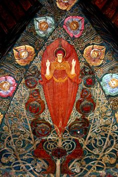 Watts Chapel interior. decorated with bright earthy colours, close to medieval tastes with royal reds and deep greens.