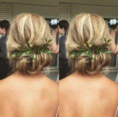 Wedding updo. Bridesmaid updo. Low bun. Greenery in hair.