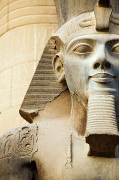 Egypt, Luxor Temple, Close up of Colossal Seated Statue of Ramses II