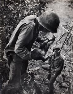 W. Eugene Smith - Wounded, dying infant found by American soldier in Saipan Mountains, 1944 © [1944], 2008 The Heirs of W. Eugene Smith