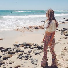 Missing the sand waves and mermaids of Byron Bay  Selene Flares have a 60's inspired Paisley print running in a perfect pattern through the flares. A mix of pinks green yellow white and blue you'll be itching to have these hugging your legs everyday!