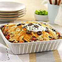 Baked Nacho Casserole - sounds easy enough to make in a short period of time and a winner for family gatherings! Mexican Dishes, Mexican Food Recipes, Beef Recipes, Cooking Recipes, Recipies, Mexican Appetizers, Mexican Meals, Nacho Casserole, Casserole Dishes