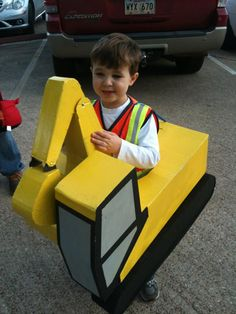 My little guy LOVES construction. My husband made him this working excavator costume for Halloween last year!