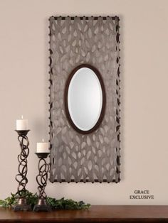 Antiqued silver leaf frame with mahogany brown accents. Mirror is beveled.  Designer: Grace Feyock  Dimensions: 21 W X 48 H X 2 D (in)  www.garbes.com