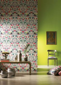 An ornate, fantastical patterned wallpaper featuring butterflies, exotic birds and mischievous monkeys. This print was originally hand-painted in our London studio for the Mother Amazon print, as seen on dresses, skirts and shirts for Spring 2016. Teal, cerise, lime and mauve pop against the grey base of the wallpaper.