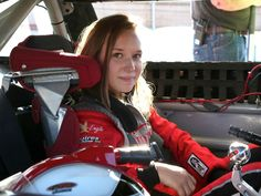 Molly sitting in race car.