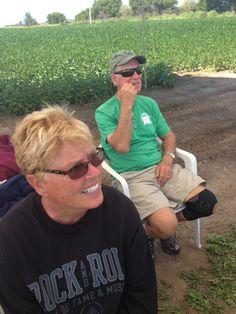 Dame Judy near a corn field