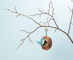 Bird feeder made with plumbing parts.