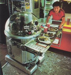 In 1983, a Chinese fast-food restaurant in Pasadena, California hired a curious-looking pair of servers: two robots named Tanbo R-1 and Tanbo R-2.    At 4.5 feet tall and 180 pounds, the robots would scoot around; bringing trays of chow mein, spareribs and fortune cookies to customers' tables.