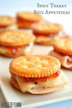 Spicy Turkey Ritz Sandwiches.  Turkey, pepperjack, pepper jelly all loaded on a Ritz cracker for a fun appetizer.