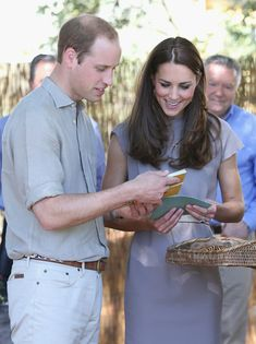 Prince William Duke of Cambridge and Catherine, Duchess of Cambridge are presented with gifts during a visit to an indigenous Training Academ on April 22, 2014