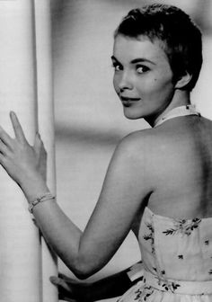 Jean Seberg, when suddenly he turns and smiles at me!