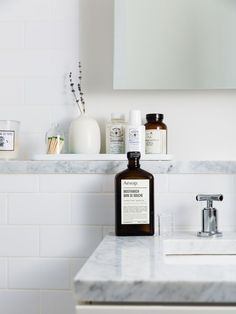 Interior design idea for minimalists: Gray and white marble bathroom with simple products and styling -- modern and clean!