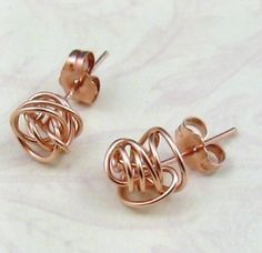 rose gold knotted earrings.