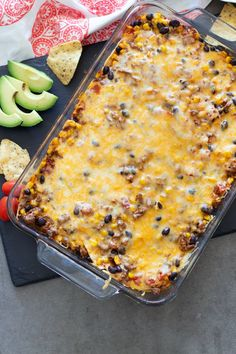This Beef Enchilada Casserole is super easy to make and deliciously tasty. You'll love the Mexican flavors of creamy refried beans, layered beef, corn tortillas, and melted cheese smothered in a flavorful enchilada sauce and baked to a bubbly perfection! #beefenchiladacasserole #casserole #mexicanfood | recipesworthrepeating.com