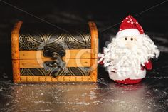 Qdiz Stock Photos | Santa Claus with wooden chest,  #background #beard #box #celebration #chest #Christmas #Claus #Clause #closeup #decoration #decorative #doll #dower #eve #Father #figure #frost #fun #funny #gift #greeting #grunge #holiday #little #Merry #metal #new #object #package #present #red #Santa #silver #small #surprise #toy #traditional #white #wood #wooden #x-mas #xmas #year