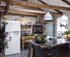 The combination of black and white color is characteristic of the modern interior of homes. Regardless of the black that we have on the floor and kitchen, this room have plenty of light. There are beames on ceiling that give a rustic touch to the whole space.