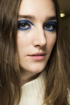 Go close-up on the hair and make-up looks backstage at the spring/summer 2015 couture shows - Versace