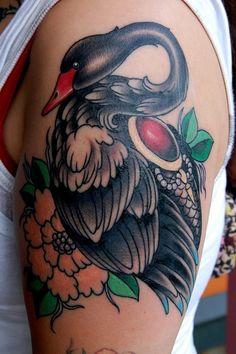 black swan flowers arm tattoo