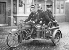 A Rex motorcycle being used by firemen