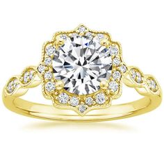 Yellow Gold is growing on me.... But I like this antique band. I would change the center to be an oval though. 18K Yellow Gold Cadenza Halo Diamond Ring, top view
