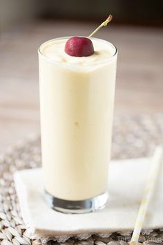 Pina Colada Smoothie with Mango - Full of pineapple, coconut milk and mango. So smooth and creamy and perfect for breakfast, too!