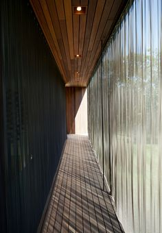 Metal-mesh curtain wall inside the Pryor Residence in Montauk, New York. Photo by: Ty Cole | Read more: http://www.dwell.com/articles/A-Sweetheart-Deal.html