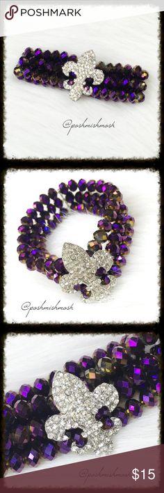 """Purple Iridescent Fleur de Lis Stretch Bracelet Purple iridescent Mardi Gras stretch bracelet with rhinestone Fleur de Lis. 7"""" unstretched. ✅MAKE OFFER✅ Jewelry Bracelets"""