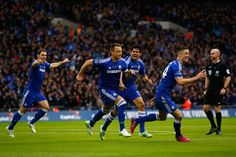 John Terry of Chelsea (C) celebrates scoring the opening goal with Diego Costa, Branislav Ivanovic and Gary Cahill of Chelsea during the Capital One Cup Final match between Chelsea and Tottenham Hotspur at Wembley Stadium on March 1, 2015 in London, England.