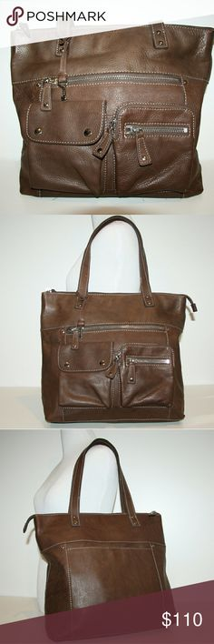 """Fossil Leather Bag chocolate brown - large tote Fossil Handbag. Color: Chocolate Brown.  Lining in great, clean condition.  Double straps.  Large exterior slip in pocket with magnetic closure.  Zip closure at top.  Large zip exterior pocket.  Two small exterior pockets, one with double snap closure and another with zip closure.   Main compartment is roomy and fully lined. Interior has 2 slip in pockets, plus one zip pocket.   14"""" wide x 13"""" tall x 4"""" deep.  9"""" drop.   Only a few very minor…"""
