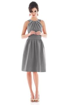 D492 in Quarry. Halter, cocktail length, bridesmaid dress by Alfred Sung. Made in a gorgeous dupioni, it features top stitched detailing on the straps and a set in shirred midriff. Pockets are included at the side seams of the full gathered skirt.