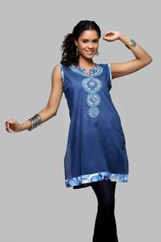 Code - 7239  Blue cotton kurti with machine embroidery on the front.