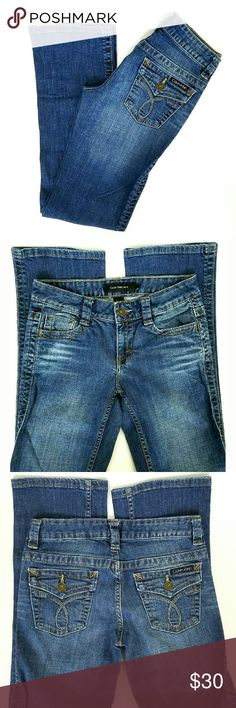 CK Lean Boot Cut Jeans CK Lean Boot Cut Jeans. 98% Cotton 2% Elastin. Factory whiskering & fading. Flap button back pockets.  EUC.  Waist 14 Rise 8 Inseam 32  No Trade or PP Bundle discounts Offers Considered Calvin Klein Jeans Boot Cut