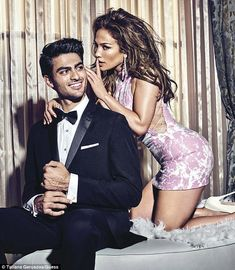Secrets: Jennifer Lopez poses next to a male model wearing a black tuxedo in a Guess adver...