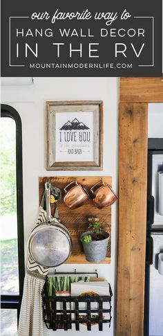 Looking for ways to easily hang frames without using screws or nails? Check out our favorite way to hang wall decor in the RV! MountainModernLife.com #glampingitems