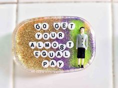 """Go get your almost equal pay"" rubber shower art 
