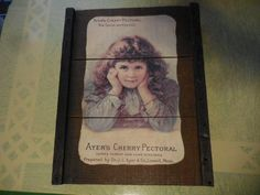 Items similar to Vintage Ayer's Cherry Pectoral For Colds/Coughs Lowell Mass. Cures Throat/Lung Disease Wood Wall Hanging Little Girl Brown Curly Hair on Etsy Jewelry Making Supplies, Craft Supplies, Brown Curly Hair, Tin Walls, Vintage Picture Frames, White Enamel, Vintage Kitchen, Wood Wall, Little Girls