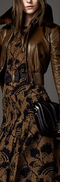 Brown and black lace dress with short brown leather jacket. The dress could stand alone. WOW...WOW...WOW...Chocolat