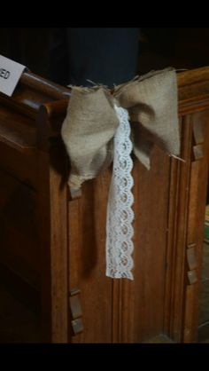 Rustic Pew ends, hessian and lace. Rustic barn wedding