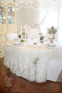 Ruffles of various fabrics in shades of white - lace, tulle, satin, faille, velvet... over the top, but pretty for a shower.