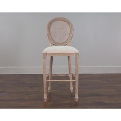 Add a unique touch to your home decor with this white antique style bar chair. It features intricate details such as the woven back and hand carved accents.