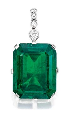 Important Platinum, Emerald and Diamond Pendant:  Suspending an emerald-cut emerald weighing 35.02 carats, topped by four old European-cut diamonds weighing approximately .35 carat.