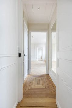 Love the floors. We like longer and wider planks in chevron pattern.  Also like the different patterns transitioning rooms.