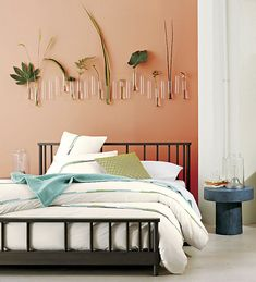 Green accents in a peach bedroom 5 Cool Paint Colors for 2014