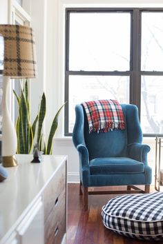 blue velvet wingback chair with buffalo check pouf