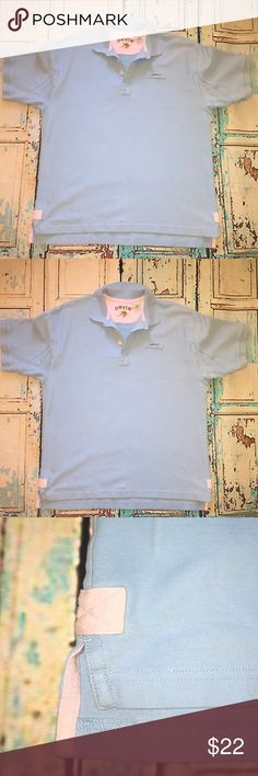 Men's Orvis Short Sleeve Polo Men's Orvis Signature Polo. 100% Peruvian Cotton. EUC. Breathable & Cool. Gussets under the arm for easy movement. Soft knit box collar. Banded sleeves. Well placed utility loop helps you stash your sunglasses. Durable construction in placket and hem promise longer wear. Color is baby blue and is finished with contrast color baby pink on seam trim and side vents. Size L. Orvis Shirts Polos
