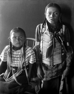 Two young Cheyenne children, girl and boy. Photograph taken around 1910.