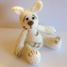 A collection of 4 crochet animal patterns: Little Bunny, Daddy Bear and his Little One, Little Puppy and Mummy Seal and her Baby
